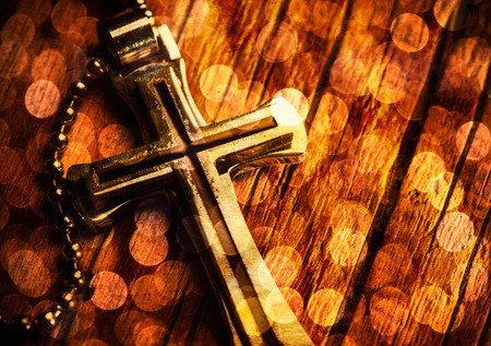 bible book: Closeup of silver Christian cross on bible