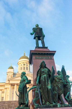 tsar: Monument to the Russian tsar Alexander II against the Cathedral in Helsinki, Finland
