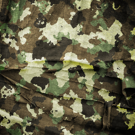 Camouflage military background with scratches and stains Stock Photo