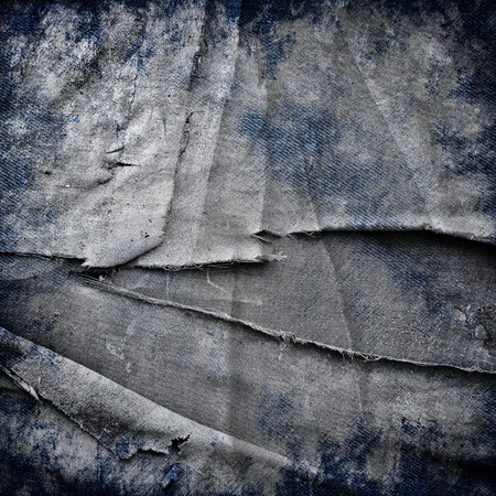 jeans background: abstract grunge jeans background with folds and scratches Stock Photo