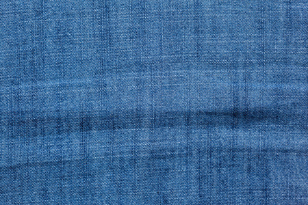 jeans background: Blue jeans background with folds close-up image