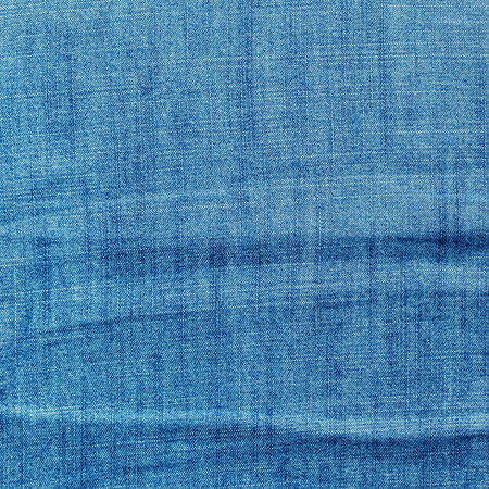 unclean: Blue jeans background with folds close-up image