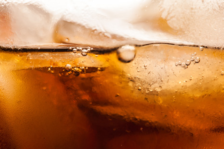 carbonation: cola with ice cubes close up image Stock Photo