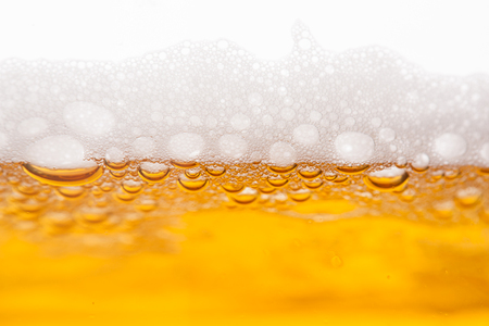 beer bubbles: Beer bubbles in a mug, close-up image