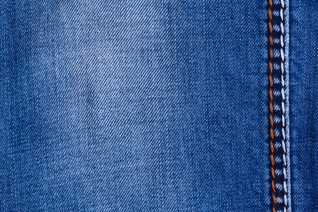 grubby: Blue jeans background with folds close-up image