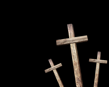 golgotha: Old brown wooden cross, on a black background Stock Photo