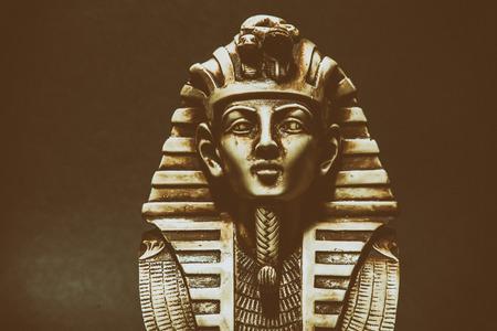 egyptology: Stone pharaoh tutankhamen mask on dark background