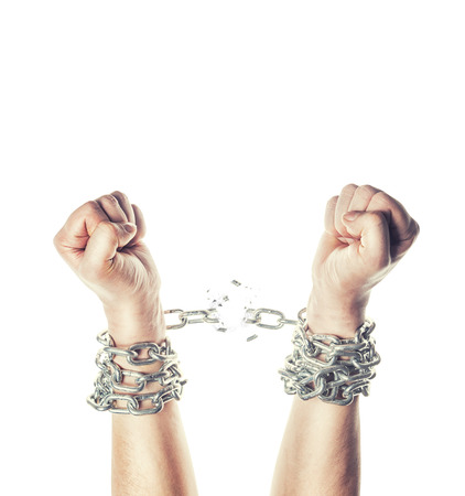 Two hands in chains on a white background 스톡 콘텐츠
