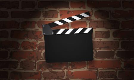 clapperboard: Movie clapperboard on a grunge brick wall