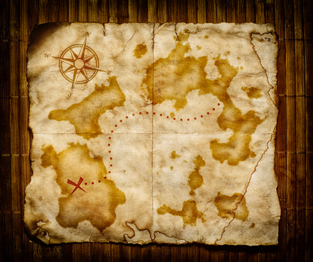 unknown age: old treasure map, on wooden grunge background