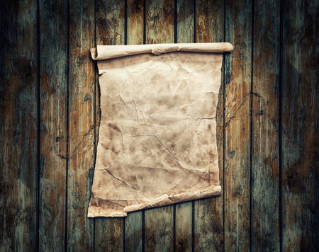 brown paper: Old brown paper on a wooden background