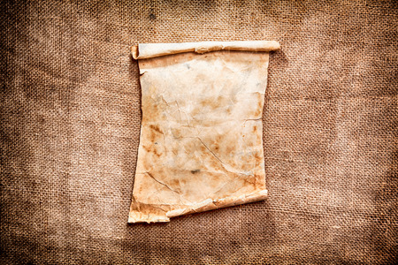 crack up: Old brown paper on a canvas background Stock Photo