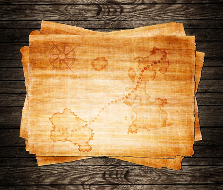 unknown age: old treasure map, on a wooden grunge background