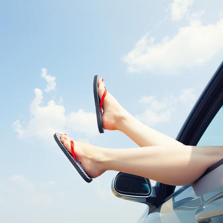 legs open: female legs dangling from the open car window in the shales