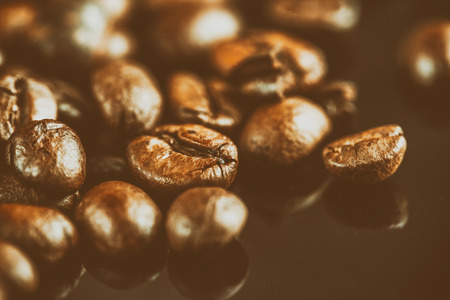 roasted coffee beans background, close-up image