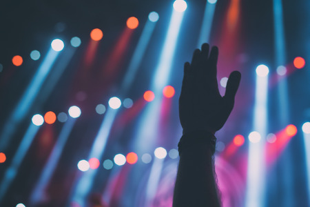 Silhouettes of people and musicians on big concert stage Stock Photo