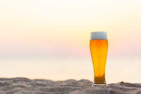 Glass of beer on a sunset Stock Photo