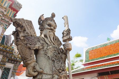 recline: Chinese Warrior Statue In The Wat Pho, Bangkok, Thailand