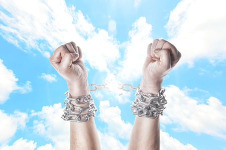 Two hands in chains on a white background Stock Photo