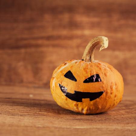 celebration: halloween jack-o-lantern on a old brown background Stock Photo