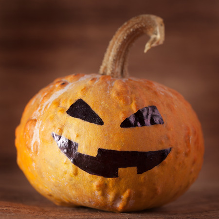 halloween jack-o-lantern on a old brown background Stock Photo