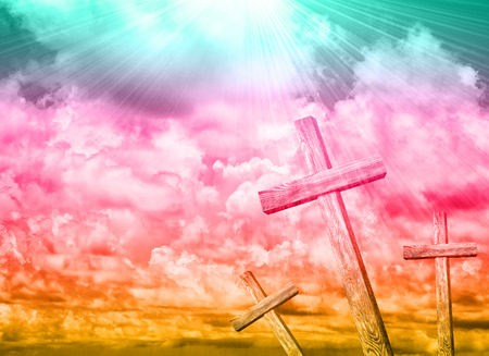 Old wooden cross on blue sky background Stock Photo