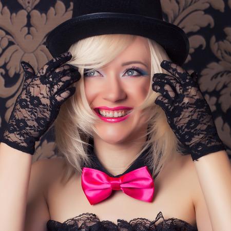 beautiful cabaret woman posing against retro wallpapers