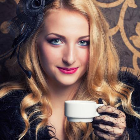 beautiful retro woman drinking coffee