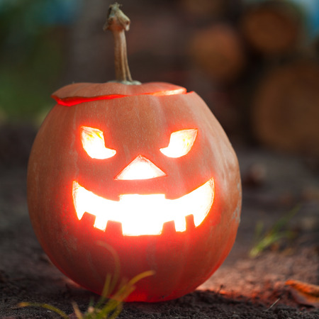 halloween jack-o-lantern standing on ground Stock Photo