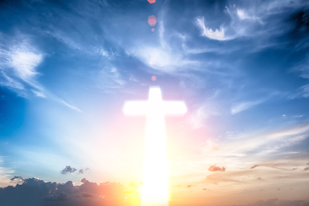 Glowing cross on beautiful sky background Stock Photo
