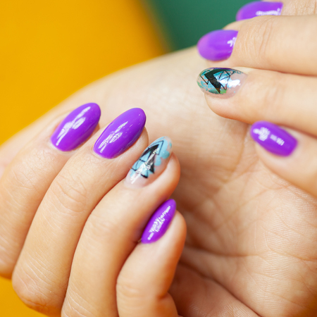 Female hands in manicure salon with a beautiful manicure Reklamní fotografie - 121843656