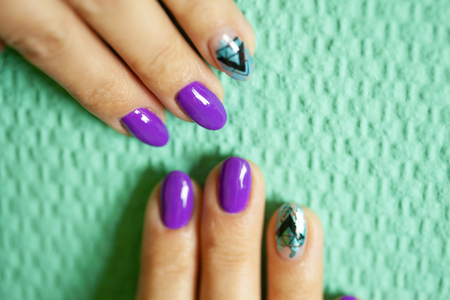 Female hands in manicure salon with a beautiful manicure Reklamní fotografie - 121843660