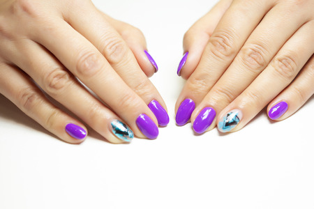 Female hands in manicure salon with a beautiful manicure