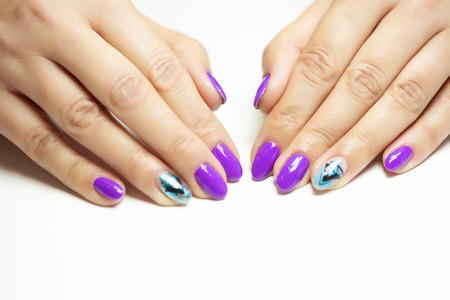 Female hands in manicure salon with a beautiful manicure Reklamní fotografie - 121843661