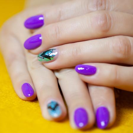 Female hands in manicure salon with a beautiful manicure Reklamní fotografie - 121847879
