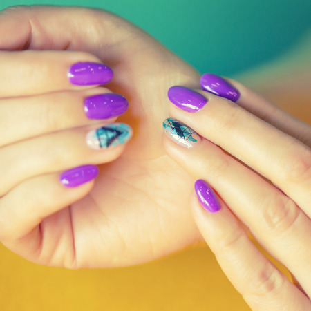 Female hands in manicure salon with a beautiful manicure