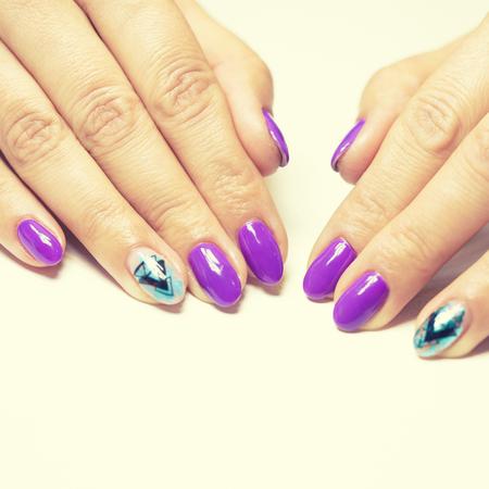 Female hands in manicure salon with a beautiful manicure Reklamní fotografie - 121847881