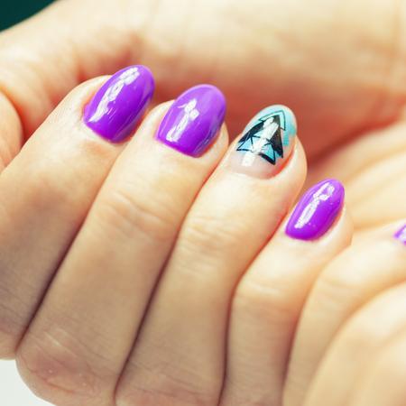 Female hands in manicure salon with a beautiful manicure Reklamní fotografie - 121847883