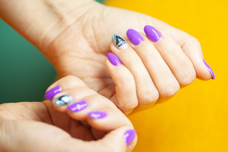 Female hands in manicure salon with a beautiful manicure Reklamní fotografie - 121847885