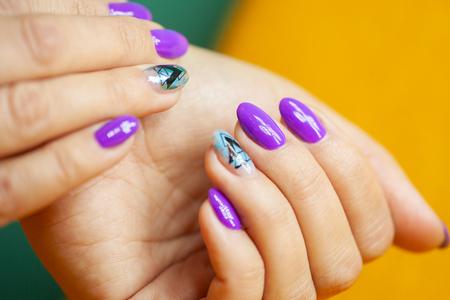 Female hands in manicure salon with a beautiful manicure Reklamní fotografie - 121845853