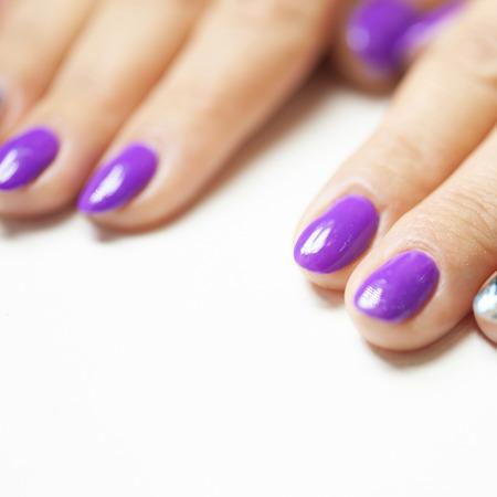 Female hands in manicure salon with a beautiful manicure Reklamní fotografie - 121845857