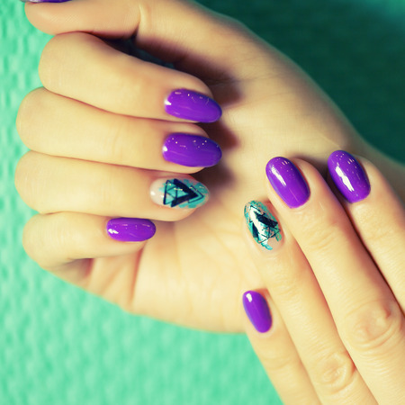 Female hands in manicure salon with a beautiful manicure Reklamní fotografie - 121845858