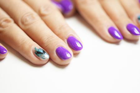 Female hands in manicure salon with a beautiful manicure Reklamní fotografie - 121845862