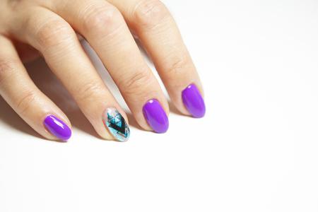 Female hands in manicure salon with a beautiful manicure Reklamní fotografie - 121845864