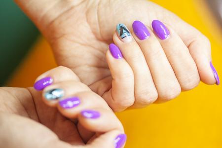 Female hands in manicure salon with a beautiful manicure Reklamní fotografie - 121845865
