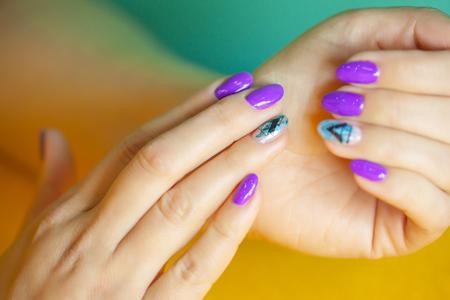 Female hands in manicure salon with a beautiful manicure Reklamní fotografie - 121845870