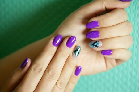 Female hands in manicure salon with a beautiful manicure Reklamní fotografie - 121845874