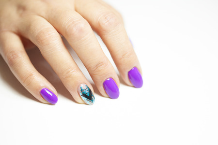 Female hands in manicure salon with a beautiful manicure Reklamní fotografie - 121944422
