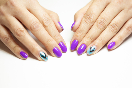 Female hands in manicure salon with a beautiful manicure Reklamní fotografie - 121845945