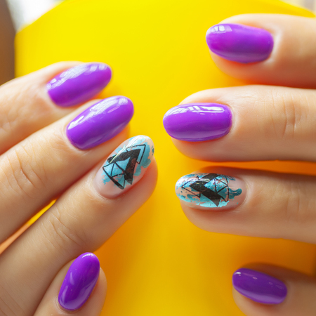 Female hands in manicure salon with a beautiful manicure Reklamní fotografie - 121845947